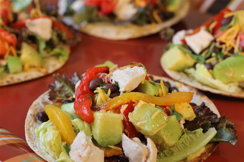 Build Your Own Chicken Tostados - Before your head out on your next family camping trip, you must check out these 26 camping recipes. We will want to try these family-friendly recipes ranging from main entrees to desserts and snacks. These meal ideas are sure to make your next campout a great success!